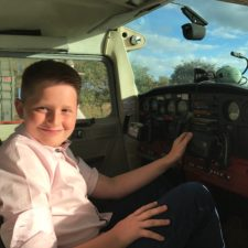 George, at the controls and ready for another flight.